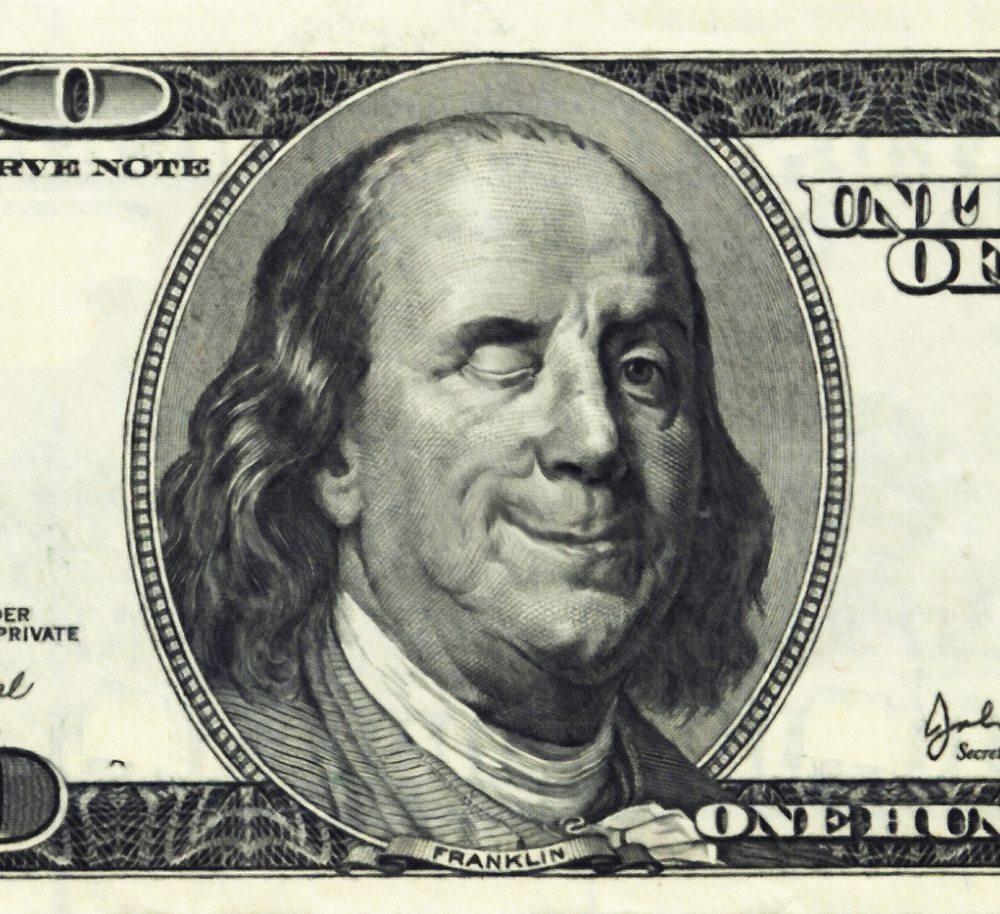Photograph of 100 dollar bill winking