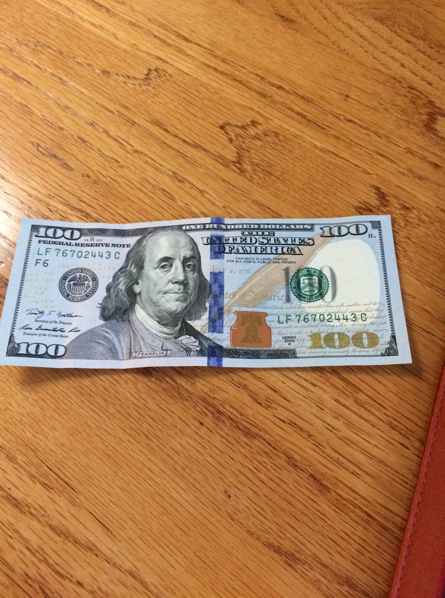 Photograph of a crisp 100 dollar bill