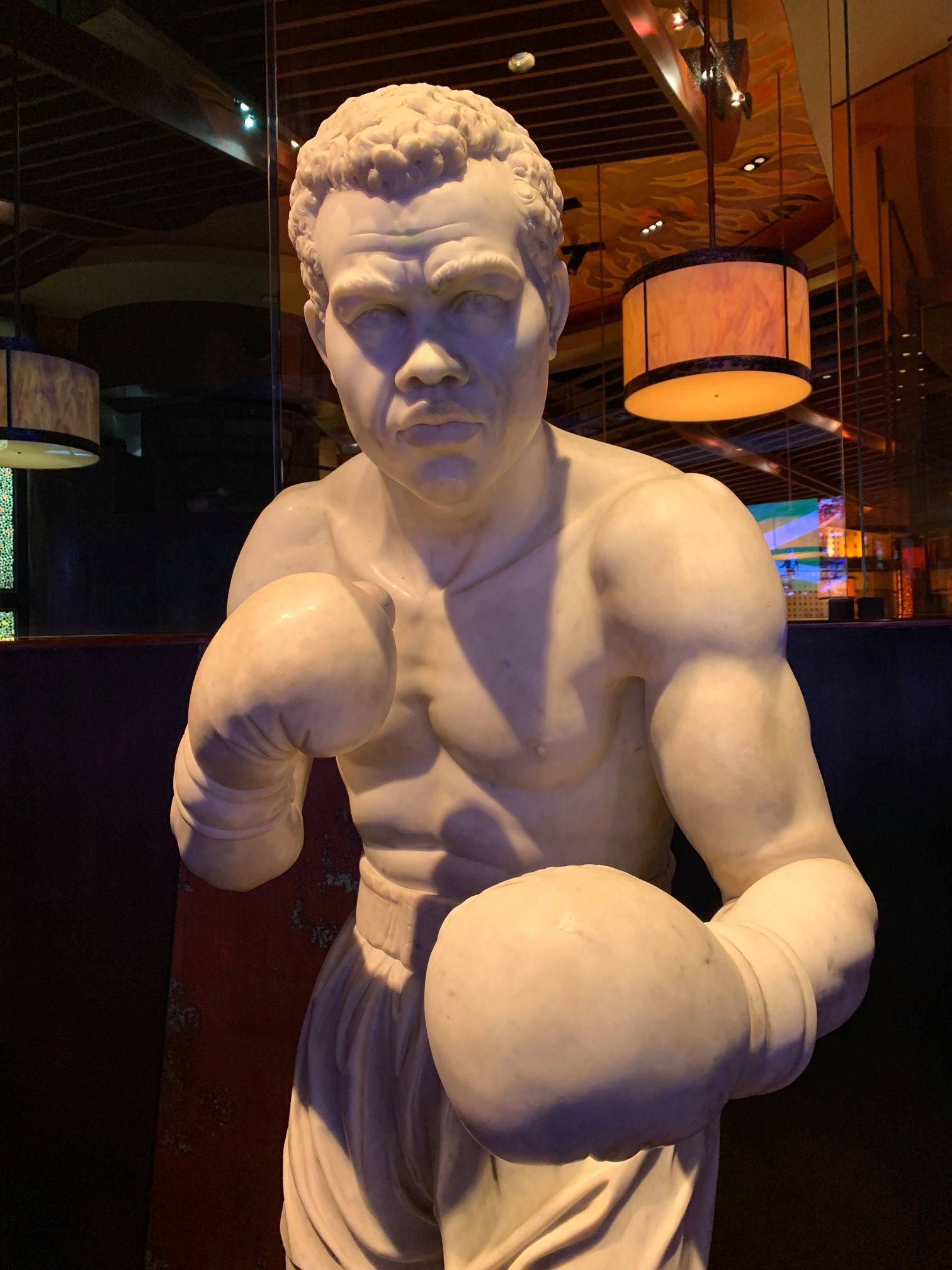 Photograph of boxer statue in hotel lobby