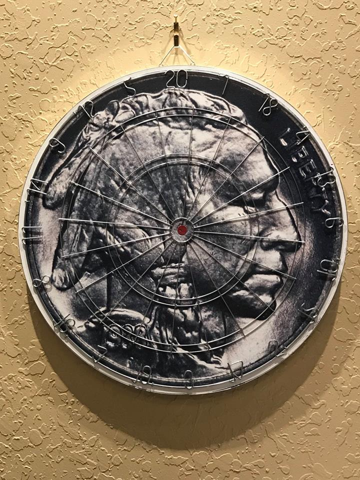 Photograph of dart board with indian